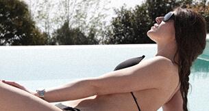 Women sunbathing in bikini