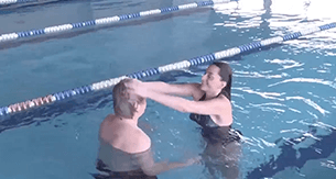 Man & woman in pool wearing the CNC hair prosthesis